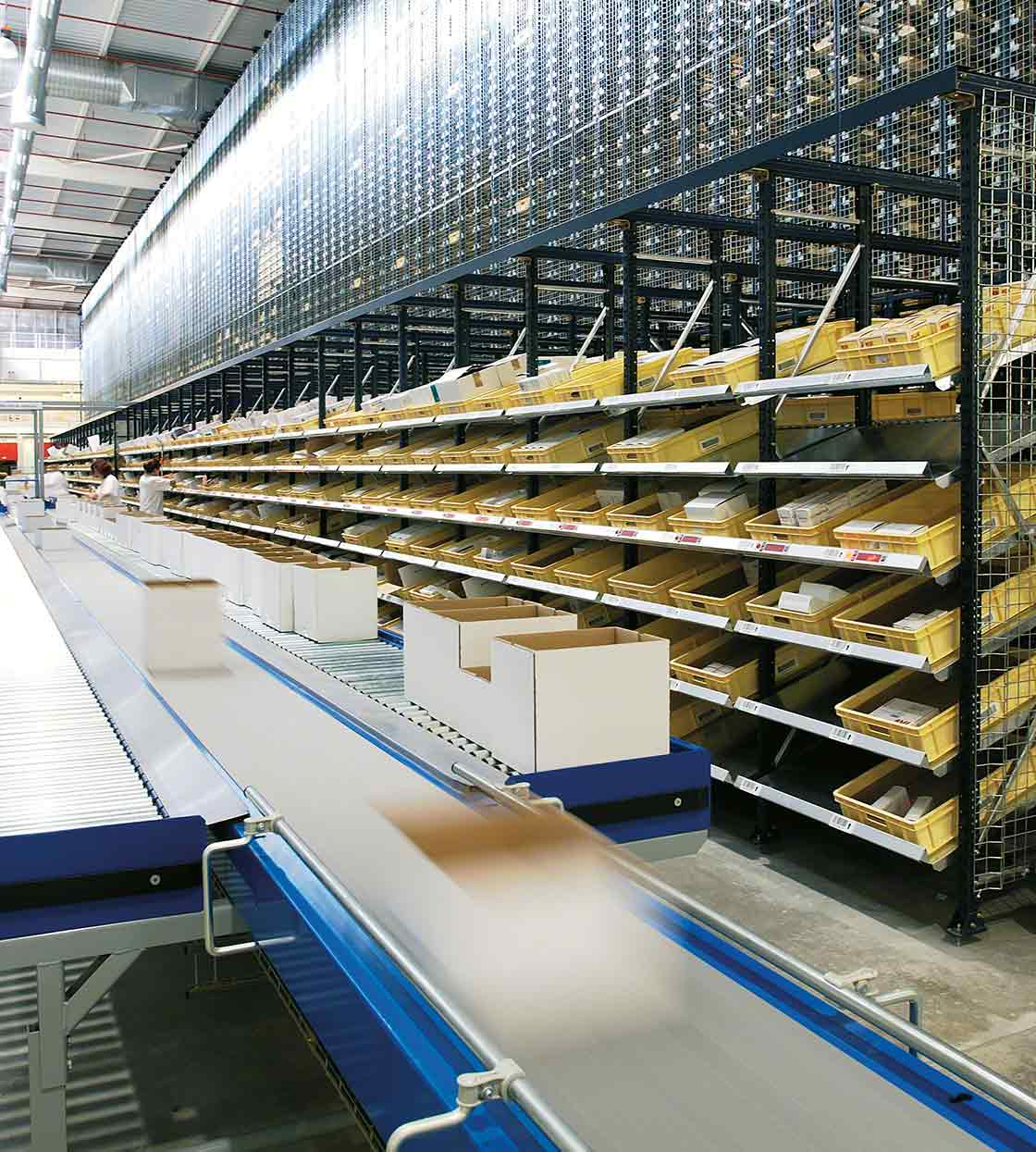 Overview of cardboard flow racking systems in a warehouse