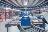 Representation of goods to person order fulfillment with manual order preparation assisted by roller conveyors