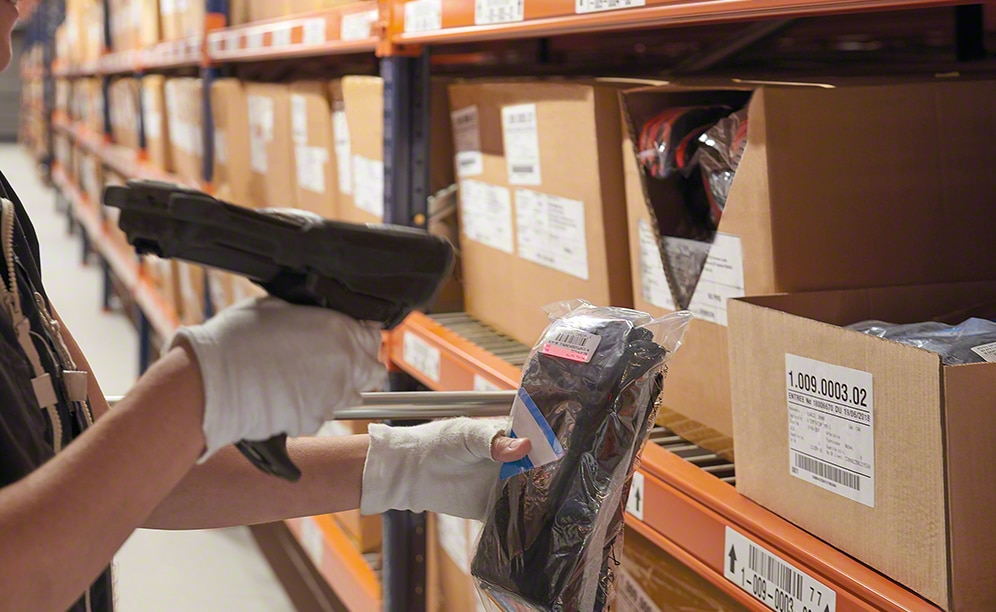 Operators collect SKUs for orders off the shelving for picking