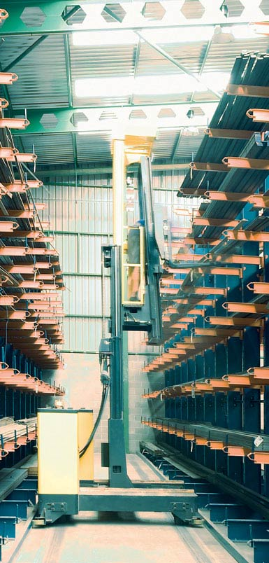 Image of a side-loading reach truck in a warehouse for metal profiles.