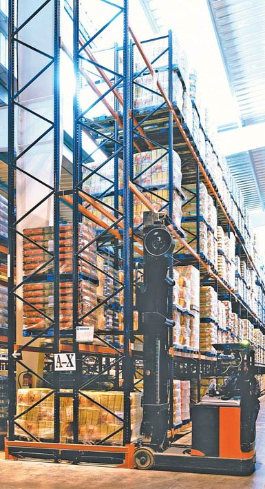 Image of a double-reach truck used in a warehouse for mass-market food products.