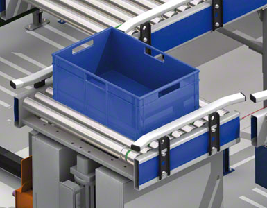 The boxes slide along the roller conveyors.