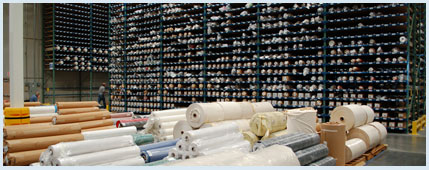 Fabric rolls in shelving compartments like crayons in a box