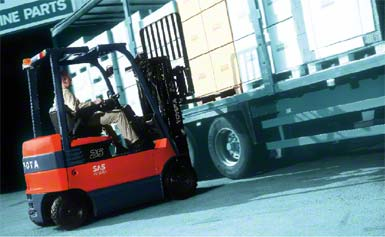 Forklift handling the goods from the side.