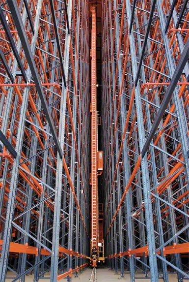 Stacker crane inside a rack-supported structure.