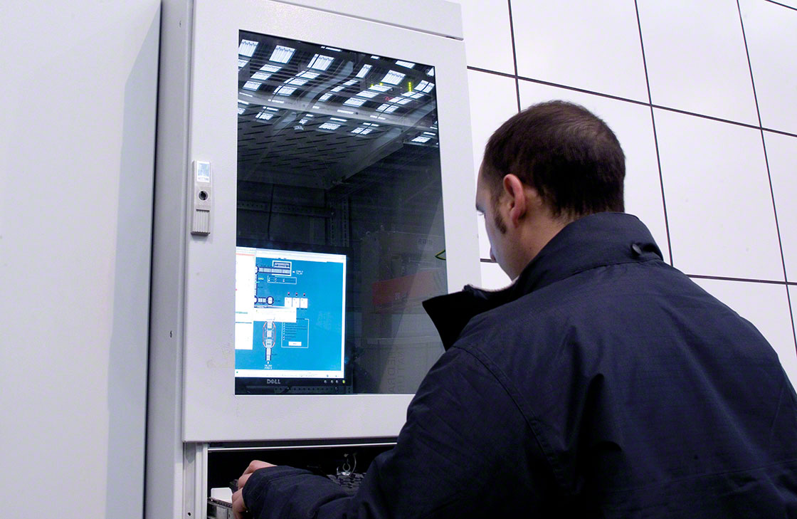 An operator checks the data log related to the tracking system